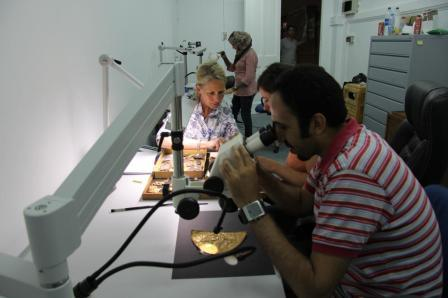 Gold relief panels under the microscope.