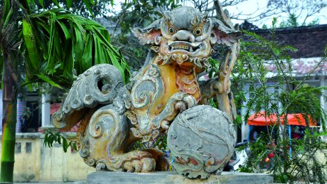 Dragon guarding the bridge to the Dinh or village hall.
