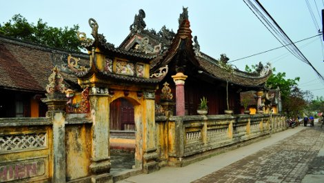 The Dinh's back wall and entrance before restoration.