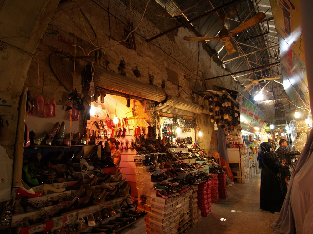 Western Qaisirya in Erbil. Bazaar walkways with temporary metal roofing.